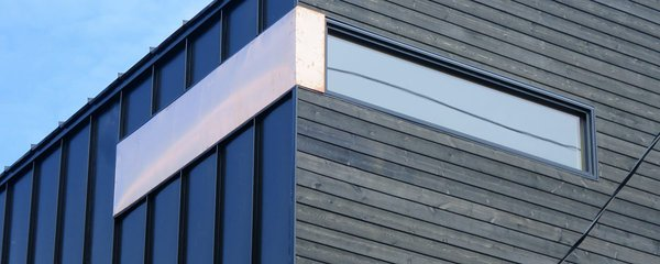 Exterior finish - metal cladding + wooden cladding.