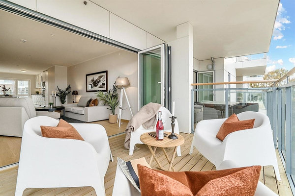 Each apartment has a balcony or terrace that extends the living room. Photo: Jesper Snekkestad