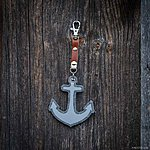 ANCHOR. Light marled grey with tan leather K1 fastening.
