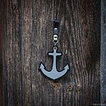 ANCHOR. Black with black leather pin fastening
