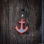 ANCHOR. Orange with black leather pin fastening