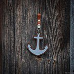 ANCHOR. Brown with tan leather pin fastening