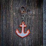 ANCHOR. Orange with tan leather K2 fastening.