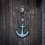 ANCHOR. Dark green with black leather K1 fastening.