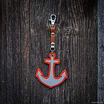 ANCHOR. Orange with tan leather K1 fastening