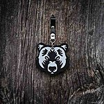 BEAR. Black with black leather pin fastening.