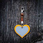 HEART. Yellow with tan leather K1 fastening.