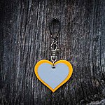 HEART. Yellow with black leather K2 fastening.