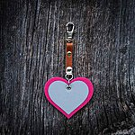 HEART. Hot pink with tan leather K1 fastening.