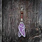 Dragonfly. Purple with tan leather K1 clasp fastening.