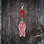 Dragonfly. Red with red textile K1 clasp fastening.