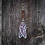 Dragonfly. Dark purple with brown textile K1 clasp fastening.