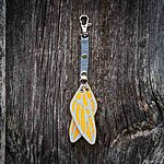 Dragonfly. Yellow with light grey textile K1 clasp fastening.