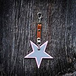 Star. Light pink with tan leather K1 clasp fastening.