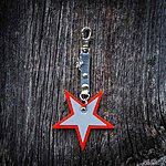 Star. Orange with light grey textile K1 clasp fastening and dragon pendant.