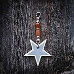 Star. Off white with tan leather K1 clasp fastening.