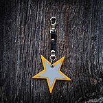 Star. Yellow with black leather K1 clasp fastening.