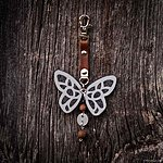 Heathered dark grey butterfly with K1 fastening, brown leather, rowan beads