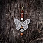Heathered light grey butterfly with K1 fastening, brown leather, rowan beads