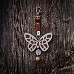 Brown butterfly with K1 fastening, brown leather, rowan beads