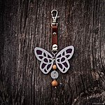Dark purple butterfly with K1 fastening, brown leather, rowan beads