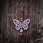Purple butterfly with K1 fastening, brown leather, rowan beads