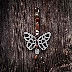 Black butterfly with K1 fastening, brown leather, rowan beads