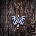 Blue butterfly with K1 fastening, brown leather, rowan beads