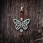 Dark green butterfly with K1 fastening, brown leather, rowan beads