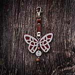 Dark red butterfly with K1 fastening, brown leather, rowan beads