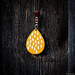 Yellow RAIN with tan leather and pin.