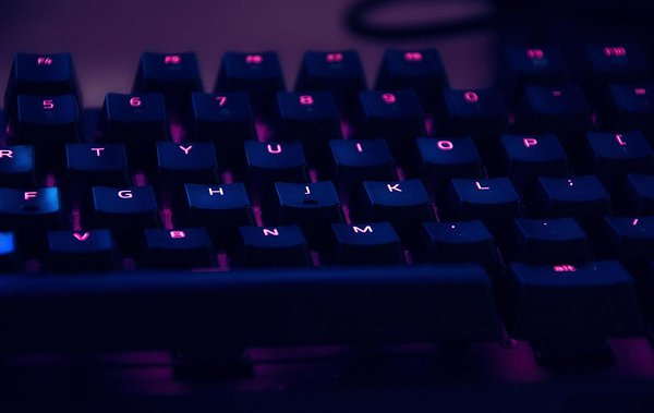 Localization image: A keyboard glowing in the dark [Credit: Photo by Anas Alshanti on Unsplash]
