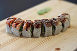 #215 BUSIDO / SALMON, TUNA, ROCK GUNNEL (BUTTERFISH), CREAM CHEESE, SPICY DRESSING, SHRIMP, UNAGI DRESSING, SESAME SEEDS / 8.80€