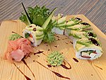 #199 GREEN DRAGON / AVOCADO, TOMATO, BELL PEPPER, WAKAME, UNAGI DRESSING, SESAME SEEDS / 10.90€