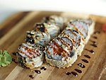 #64 CALIFORNIA TEMPURA / SALMON, CRABMEAT, CREAM CHEESE, CUCUMBER, UNAGI DRESSING, SESAME SEEDS / 9.50€