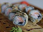 #66 NIDZU / CRABMEAT, CREAM CHEESE, SALMON, BLACK MASAGO, UNAGI DRESSING, SESAME SEEDS / 9.70€