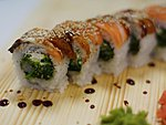#29 AKITA / EEL, SALMON, CREAM CHEESE, WAKAME, EBI, UNAGI DRESSING, SESAME SEEDS / 9.90€