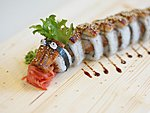 #38 DRAGON / EEL, CRABMEAT, SALMON, CUCUMBER, AVOCADO, UNAGI DRESSING, SESAME SEEDS / 14.30€