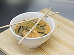 #202 KIM CHI SOUP / SALMON, SEA BASS, WAKAME, SESAME SEEDS, KIM CHI / SPICY / 3.50€