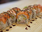 #31 LATUN / SALMON, EBI, CUCUMBER, AVOCADO, CREAM CHEESE, SNOWCRAB, UNAGI DRESSING, SESAME SEEDS / 9.50€