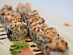 #55 BANZAI / SALMON, CREAM CHEESE, SHRIMP, CUCUMBER, UNAGI & SPICY DRESSING, SESAME SEEDS / 9.20€
