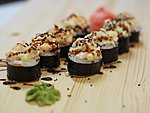 #59 DOUBLE ROLL / SALMON, SQUID, BUTTERFISH, MAYONNAISE, CREAM CHEESE, CRABMEAT, UNAGI DRESSING, BLACK SESAME SEEDS / 9.60€