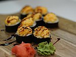 #57 YOTO / CHEESE, SHRIMP, CRABMEAT, CUCUMBER, AVOCADO, CREAM CHEESE, MASAGO, UNAGI DRESSING, SESAME SEEDS / 8.90€