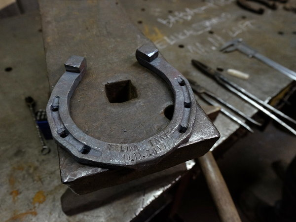 A lucky horseshoe forged with the help of a groom.