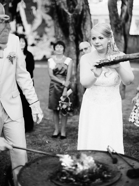 The bride keeps the fire going.