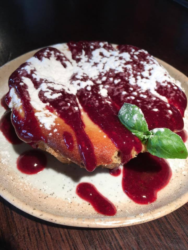 Baked orange-ricotta cheese cake with berry sauce