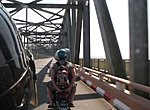 crossinf a bridge on motorbikes