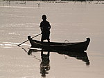a boy reflecting in Mekong river, Myanmar