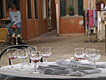 an unattended table on Burano island, Italy