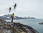 Veiga, kayak guide in Greenland. Group portrait with flies